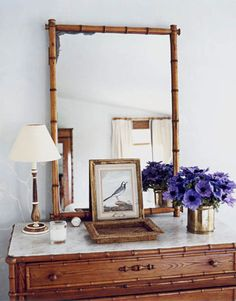 The Guest Bedroom Furniture. The guest room's suite of faux-bamboo furniture includes a chest, mirror, and armoire (reflected in mirror). Bedroom Dressers, Bedroom Furniture, Bedroom Decor, Bedroom Ideas, Master Bedroom, Rattan, Wicker, Bamboo Cabinets, Bamboo Mirror