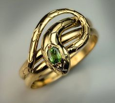 Antique Demantoid Gold Snake Ring | From a unique collection of vintage more rings at https://www.1stdibs.com/jewelry/rings/more-rings/ #GoldJewelleryUnique #JewelryRings