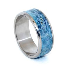 Custom Wedding Ring All that We See - This beautifully crafted, titanium wedding ring has a center inlay of Blue Box Elder. Nicely polished with a mirror finish and fully rounded edges. Pictured at Blue Wedding Rings, Custom Wedding Rings, Wedding Bands, Titanium Rings For Men, Titanium Wedding Rings, Unique Diamond Engagement Rings, Unique Rings, Blue Box, Mirror