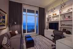 Home office and TV room combo is a practical and ergonomic choice [Design: Michael Abrams Limited]