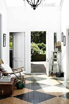 light and bright modern entry way with painted floors / sfgirlbybay