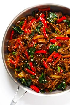 This quick and easy Japchae (Korean Noodle Stir-Fry) recipe takes less than 30 minutes to make, it's easy to customize with whatever veggies and protein you have on hand (or it can be vegan if you go with tofu or veggies-only), and it's totally delicious. Korean Glass Noodles, Stir Fry Noodles, Japchae Noodles, Gimme Some Oven, Asian Recipes, Ethnic Recipes, Healthy Recipes, Vietnamese Recipes, Sweet Potato Noodles