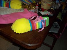 How to make your own clown shoes. I'd use large foam balls to accomplish this task, but this works well too