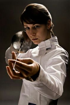 View top-quality stock photos of Female Fencer Holding Fencing Foil. Find premium, high-resolution stock photography at Getty Images. Fencing Foil, Fencing Sport, Epee Fencing, The Fencer, Sword Poses, Style Blog, Olympic Fencing, Photo D Art, Poses References