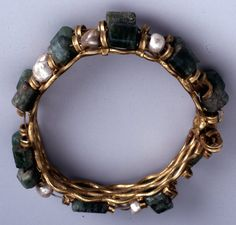 Gold bracelet set with emeralds and pearls strung on gold wire. Roman; 1stC; Egypt;