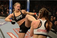 LAS VEGAS, NV - DECEMBER 28:  (L-R) Ronda Rousey kicks Miesha Tate in their UFC women's bantamweight championship bout during the UFC 168 event at the MGM Grand Garden Arena on December 28, 2013 in Las Vegas, Nevada. (Photo by Donald Miralle/Zuffa LLC/Zuffa LLC via Getty Images) *** Local Caption *** Ronda Rousey; Miesha Tate