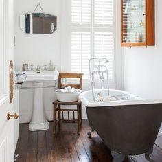 All-white bathroom with roll-top bath and shutters Dark Floor Bathroom, White Bathroom Cabinets, Wooden Bathroom, Bathroom Flooring, Small Bathroom, Neutral Bathroom, Light Bathroom, Attic Bathroom, Basement Bathroom