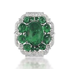 Christies auction Geneva May 15th,2013 ART DECO EMERALD AND DIAMOND BROOCH, BY CARTIER  Centering upon a cabochon emerald within smaller cabochon emerald surround, to the pavé-set diamond frame enhanced by square-cut diamond collets, 1930s, 5.0 cm, with French assay mark for platinum.  Beautiful