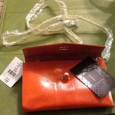 Genuine leather Crossbody NWT Orange color, with lots of pockets.  Gold chain strap. New!❤️❤️❤️ Black Saks Fifth Avenue Bags Crossbody Bags