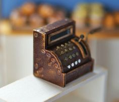 This post is the second time today. :-) I made miniature antique cash register. I looked for a model of antique cash register to make mini...