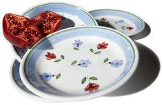 """Caleca Petali 4-Piece Soup Plate Set by Caleca. Save 34 Off!. $26.50. Chip-resistant. Caleca Petali means Petals, soft wavy bordeaux and light blue flowers dispersed randomly on a white background. All natural majolica/ceramic components individually hand-painted with non-toxic glazes and colors. Dishwasher safe; microwavable. Includes four art; 414 soup plates. Pinzon Petali earthenware enhances any tabletop with fresh, subtle color. The Petali, or """"petals"""", pattern was designed…"""