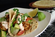 Blackened Shrimp Tacos with Spicy Chipotle Crema   Recommended Music: Latin Radio (Spotify Radio Station)     It's the time of year where t...