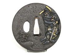 A marugata Shoki tsuba in iron decorated and inlaid in taka zogan of shakudo. http://www.espace4.com/wp-content/uploads/2014/01/tsuba-marugata-fer-shakudo-or-argent-takazogan-shoki-oni-japon-sabre.jpg