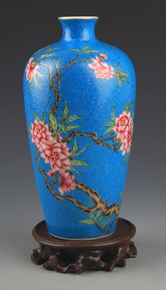 A BLUE GLAZED FAMILLE-ROSE PLUM BOTTLE. Qing Dynasty, H:8.2 in