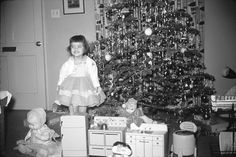 1950's-60's Christmas... we were not wealthy, but had the BEST celebrations... wasn't all about the presents (my dad was crafty and my mom had a great imagination)... we had wonderful traditions too. One of my fav was a tangerine (every year) in the toe of my stocking  oh... and a maple sugar candy figurine <3