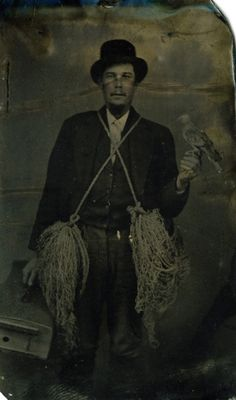 ca. 1870, [tintype portrait of a falconer with Kestral falcon, nets, and cage]