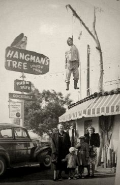 "The Hangman's Tree restaurant, advertising lousy food and warm beer. and a ""hanged man""."
