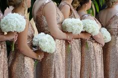 All white hydrangea bouquets by Design House Weddings.