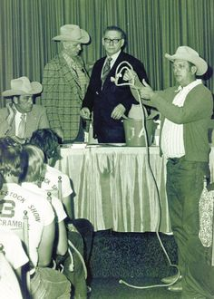 Did you know that the first calf scramble took place at the Houston Fat Stock Show in 1942, just 10 years after its inception. Today, Calf Scramble Committee members still gather the youth to explain the rules of the event and how to properly halter their calf. In this Retro Rodeo photo, Emmett Evans demonstrates how to use the halter!