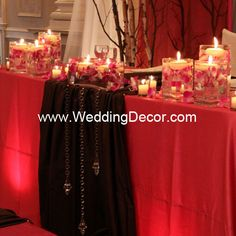 Wedding Decor  Head Table - fuchsia linens, brown runners, hanging crystals and fuchsia orchids in glass vases with floating candles