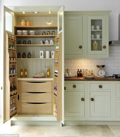 Pack it in: Larders like this one by Harvey Jones offer heaps of storage space for all you...
