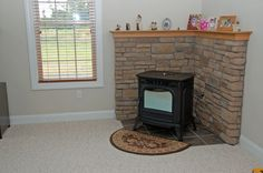 Love the idea of mantle. Freestanding Fireplace, Small Fireplace, Fireplace Mantle, Mantle Shelf, Wood Stove Wall, Corner Wood Stove, Small Wood Burning Stove, Pellet Stove, Living Room Update