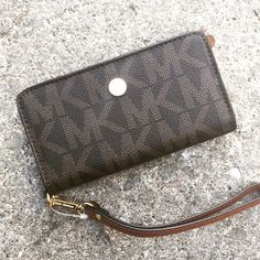 New Auth Michael Kors Signature iPhone 6 Wallet! Brand new! 100% authentic! This will fit the iPhone 6! Perfect for cash, cards, change, and your phone! Any questions, please ask! Michael Kors Bags Clutches & Wristlets