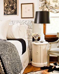 From Celerie Kemble's Black & White (and a bit in between). I'm obsessed with that headboard fabric! It's a bit like B&F's Les Touches, no?