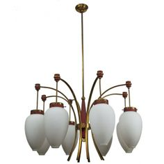 """Italian Mid Century Chandelier by Luigi Molin --- Luigi Molin circa 1960 chandelier has eight white glass globes suspended on a brass tube frame with red accents. New wiring for US electrical standards. Height shown below is with canopy and rod, fixture itself is 16.5"""" tall. ---  Item:  3432 --- Retail Prices:  $3595"""