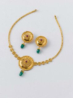 Necklace - 10.200 gm, Rs 35,300/- Earrings - 3.150 gm, Rs 10,900/-