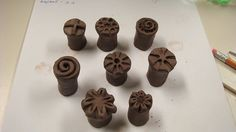 Make your own clay stamps (The best way to make these is to use the tip of an pencil, like making the little flower down right.)
