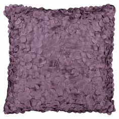 Pillow in plum with a textured circles design.   Product: PillowConstruction Material: Polyester coverColor: PlumFeatures:  Insert includedZipper closure Cleaning and Care: Fluff filler pillow. Blot stains immediately. Test cleaning products in discreet area. Dry clean cover.