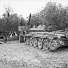 A Scammell Pioneer recovery lorry tows a disabled Crusader tank into a REME workshop, 12 February Army Vehicles, Armored Vehicles, Crusader Tank, Afrika Corps, Bedford Truck, World Tanks, Tank Armor, Armored Fighting Vehicle, Norte