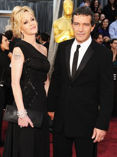 Melanie Griffith, in Yves Saint Laurent, arrives at the Academy Awards with Antonio Banderas, wearing a Giorgio Armani tux.