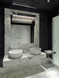 Luxury bathroom with marble vanity and high-end fixtures. http://www.hgtv.com/bathrooms/13-black-and-white-bathrooms/pictures/index.html?soc=pinterest