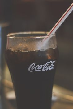 refreshing glass of icy coca-cola