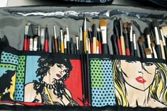 adore this makeup brush roll bag... if i could find superhero fabric, i'd totally DIY it.