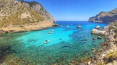 a small cove with boats moored up in mallorca