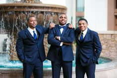 Groom and groomsmen in navy blue tuxedos {New Seasons Photography}