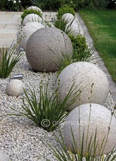 These cool and unique DIY Garden Globes are a bold statement for the modern garden room but can be softened with pretty intertwining flowers. Next Previous Cool and Unique DIY Garden Globes Garden Globes, Concrete Garden, Diy Concrete, Concrete Projects, Gravel Garden, Concrete Edging, Concrete Curbing, Pebble Garden, Concrete Stone
