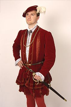NINYA MIKHAILA - HISTORICAL COSTUMIER 1540s courtier's suit made for JMDCo at Hampton Court Palace. Based on a painting in the Royal Collection of an unknown man. Suit consists of doublet, hose and gown and bonnet in red silk velvet with red and gold striped 'pullings out'. Blackwork embroidery on shirt worked by Jane Huggett.