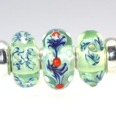 Trollbeads Gallery - Twins & Trios with a great heart bead! So artistic and so well done. http://www.trollbeadsgallery.com/twins-trios-188/