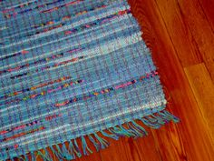 Denim Rag Rug with Vibrant Vintage Fabric by QuietStorytellers
