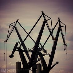 Industrial cranes in Gdansk shipyards by piccaya. Industrial view massive cranes in the Shipyards in Gdansk, Poland. Industrial Architecture, Heavy Equipment, Creative Photography, Crane, Utility Pole, Stock Photos, Gdansk Poland, Modernism, Travelling
