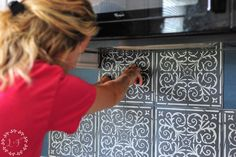 This DIY High End Patterned Tile Backsplash Look is for anyone how is short on cash but long on time. A little paint, patience, & liquid nails transforms...