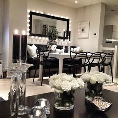 Love the dinning room table and the decor on the coffee table.. ooh and that lighted mirror.