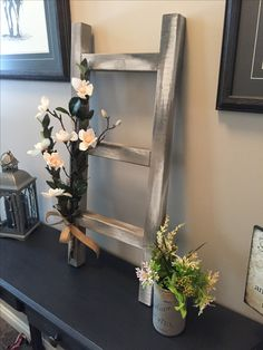 Decorative ladders that be hung used as table top or placed on the floor done with Annie Sloan's chalk paint