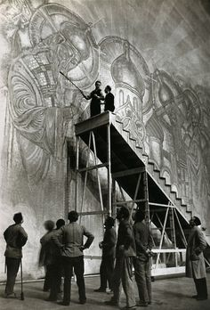 Alfred Eisenstaedt. From a high platform at La Scala, stage designer Nicola Benoit works on a backdrop for Rimsky Korsakov's opera Legend of the Invisible City of Kitzeh, 1934