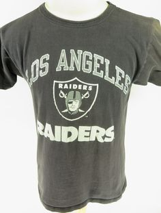 Vintage 80s Champion Oakland Raiders T-shirt. Find more men's and women's authentic vintage clothing at The Clothing Vault.