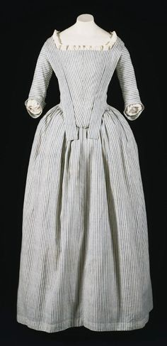 Robe à l'Anglaise, Pensnylvania/United States, c,. 1775-1780s. White and blue striped cotton. This gown is a rare surviving example of the type worn by servants and the lower classes, or by middle class women for informal wear.
